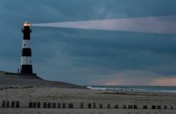 Vuurtoren Breskens lighthouse in the Netherlands shining in the